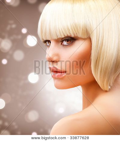 Blond Hair. Haircut. Hairstyle. Beautiful Model over Blinking Holiday Background