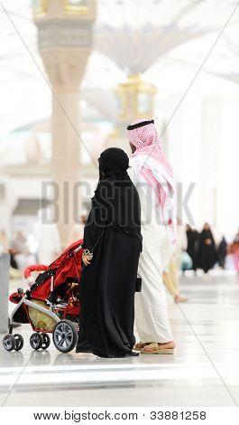 Saudi Arabian family walking