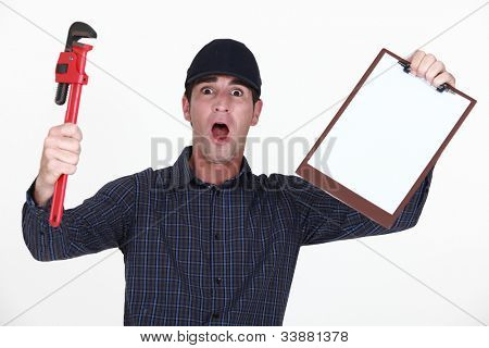 Outraged plumber holding clip-board
