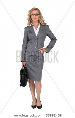 Woman in a business suit with her hand on her hip