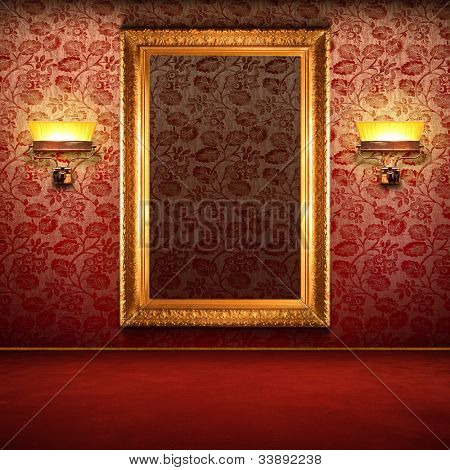 Red retro interior with empty exposition in gold frame and wall lights