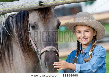 Horse and girl - Lovely cowgirl and pony on a ranch