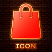 Glowing Neon Handbag Icon Isolated On Brick Wall Background. Shoping Bag Sign. Woman Bag Icon. Femal poster