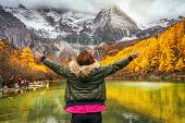Back Side Of Asian Traveler Woman Looking And Sightseeing Over The Pearl Lake With Snow Mountain In  poster