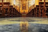 stock photo of pews  - Interior of a beautiful old catholic church from below with marble floor - JPG