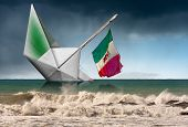 White Paper Boat With The Italian Flag That Are Sinking In A Rough Sea With Waves And Sky With Rain. poster