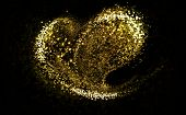 stock photo of gold-dust  - Heart of gold glittering stars dust trail - JPG