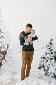A Father Holds His Young Son In His Arms In The Winter Forest. Happy Fatherhood. Christmas And New Y poster
