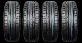 Studio Shot Of A Set Of Summer Car Tire Isolated On Black Background. Tire Stack. Car Tyre Protector poster