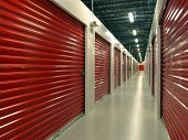picture of self-storage  - Red door Storage Units with hallway perspective - JPG
