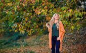Cozy Outfit Ideas For Weekend. Woman Walk Sunset Light. Cozy Casual Outfits For Late Fall. Comfortab poster