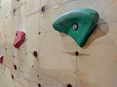 Colorful Climbing Pieces On A Wall In A Gym For Climbing Exercise Both For Leisure And Professionall poster