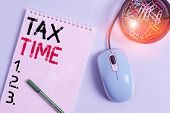 Text Sign Showing Tax Time. Conceptual Photo Compulsory Contribution State Revenue Levied Government poster