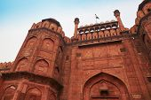Red Fort Or Lal Qila In Delhi, India. Ancient Fort Made Of Red Sandstone With India Flag On Top. Arc poster