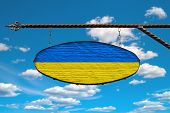 Ukraine Flag On A Signboard. Oval Signboard Colors Ukraine Flag Hanging On A Metal Forged Structure. poster