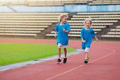 Child Running In Stadium. Kids Run. Healthy Sport. poster