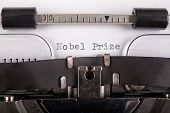 The Inscription nobel Prize On A White Sheet In A Typewriter. Nobel Prize In Literature. Light Bac poster