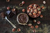 Chocolate Nut Paste, Hazelnuts And Dark Chocolate. Ingredients Concept Of Natural Chocolate Nut Past poster