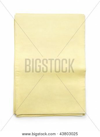 Stack Of Blank Yellow Newspapers