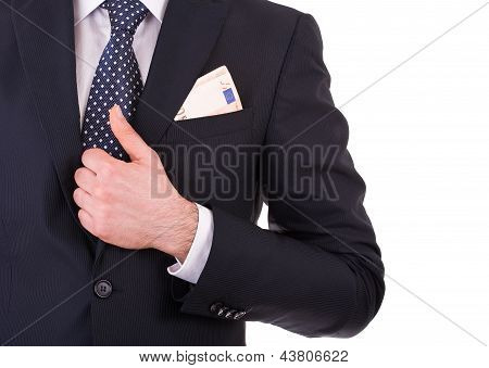 Businessman with money in suit pocket.