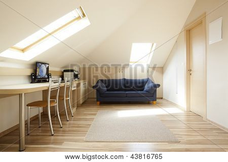 Modern room with mansard windows