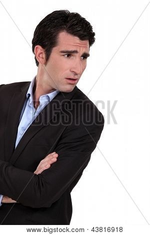Businessman with his arms folded in disbelief