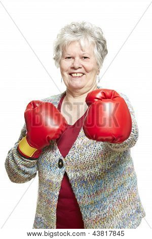 Senior Woman Wearing Boxing Gloves Smiling