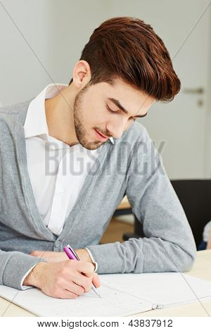 Man taking exam as student in university lecture