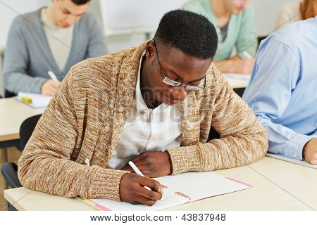 African student learning in a university class