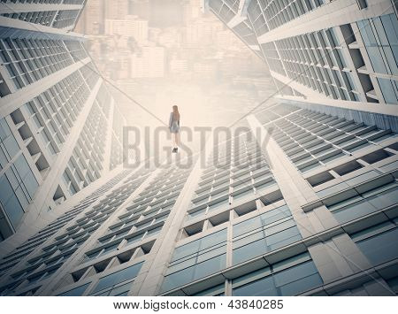 Photo compilation of business woman stand on top of skyscraper, concept for escape from work, freedom, urban life etc.