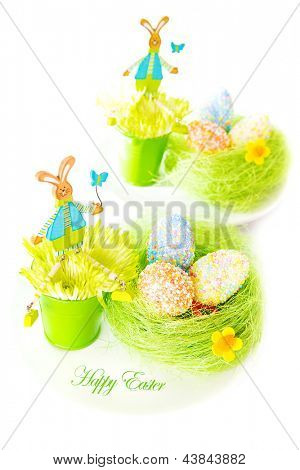 Beautiful festive Easter still life isolated on white background, colorful eggs, bunny toys, traditional Christian Eastertime symbol