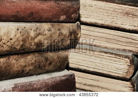 closeup of some piles of old books