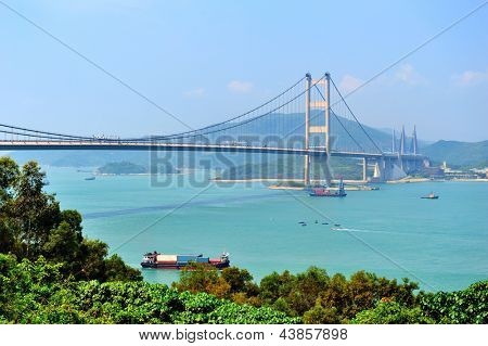 Tsing Ma Bridge in Hong Kong over sea in the day with blue sky