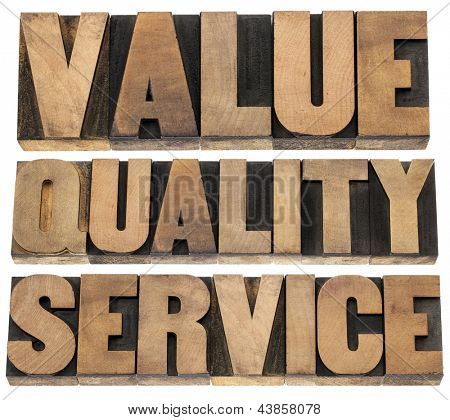 value, quality, service- business mantra concept - isolated words in vintage letterpress wood type printing blocks