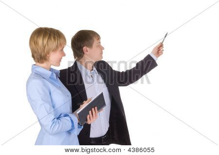 Portrait Of Businessman Pointing At Wall With Woman Near By