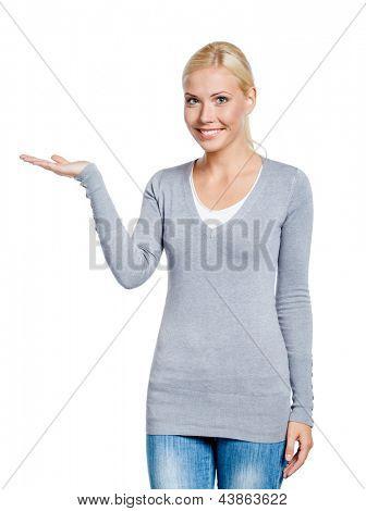 Girl palms up showing something, isolated on white