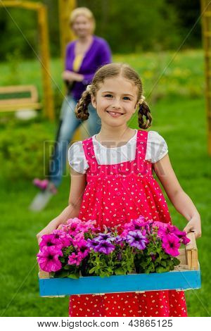 Gardening, flower garden, planting concept - lovely gardener working with mother in the garden