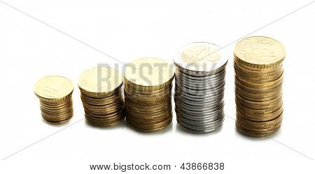 Many coins in columns isolated on white
