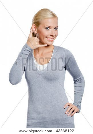 Female gesturing phone call with hand, isolated on white