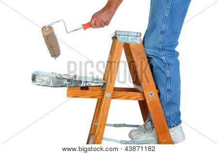 Closeup of a painter standing on a ladder with a roller dripping paint. Man is unrecognizable on a white background.