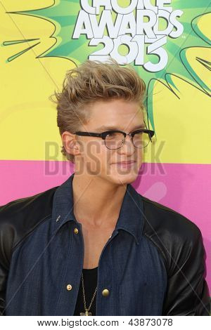 LOS ANGELES - MAR 23:  Cody Simpson arrives at Nickelodeon's 26th Annual Kids' Choice Awards at the USC Galen Center on March 23, 2013 in Los Angeles, CA