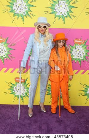 LOS ANGELES - MAR 23:  Ke$ha, Louie Sebert arrive at Nickelodeon's 26th Annual Kids' Choice Awards at the USC Galen Center on March 23, 2013 in Los Angeles, CA
