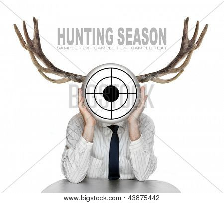Unsuccessful manager (politician, boss, worker, etc) with shooting target and great antlers. Funny picture from the office.