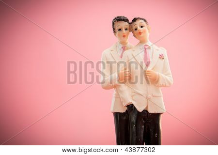 Gay groom cake toppers on pink background