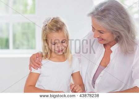 Grandmother talking with her granddaughter indoors