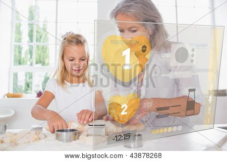 Grandmother and granddaughter baking with holographic interface