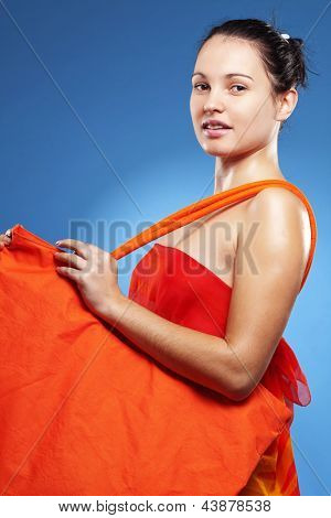 Beautiful young woman wearing big summer bag studio series