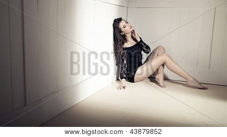 Young beauty brunette over white wall
