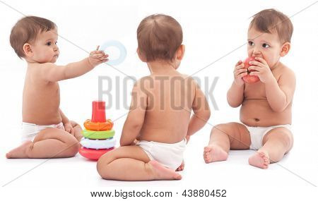 Three babies play on the floor. Montage.