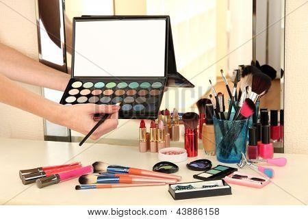 Cosmetics on table near mirrow